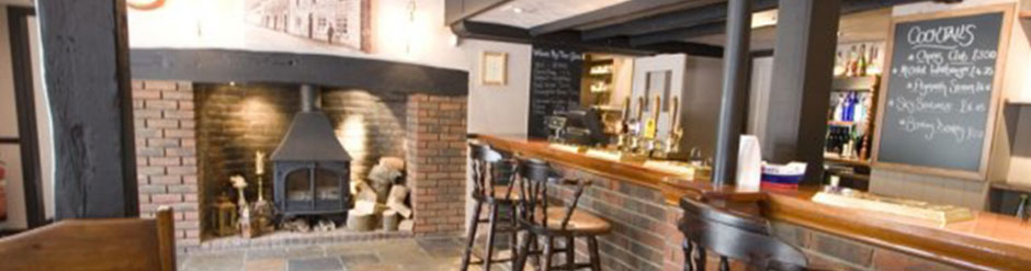 The Bar & Log fire at Swan at Stoford